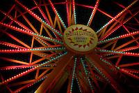 A nightime HDR photo of the farris wheel at The Arkansas Oklahoma State Fair.
