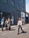 ENGLAND, Brighton, Girl Walking down Upper Gardner Street