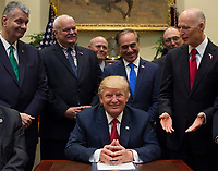 United States President Donald Trump smiles after signing S. 544 the Veterans Choice Program Extension and Improvement Act after signing it in the Roosevelt Room at the White House in Washington, DC on April 19, 2017. Photo Credit: Molly Riley/CNP/AdMedia