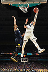 SAN ANTONIO, TX - APRIL 02: Donte DiVincenzo #10 of the Villanova Wildcats drives to the basket against Charles Matthews #1 of the Michigan Wolverines during the second half of the 2018 NCAA Men's Final Four National Championship game at the Alamodome on April 2, 2018 in San Antonio, Texas.  (Photo by Jamie Schwaberow/NCAA Photos via Getty Images)