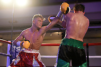 Jonny Phillips (red shorts) defeats Josh Thorne during a Boxing Show at the Camden Centre on 10th March 2018
