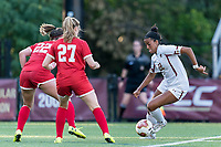 NEWTON, MA - AUGUST 29: Jillian Jennings #22 of Boston College dribbles in a crowd during a game between Boston University and Boston College at Newton Campus Field on August 29, 2019 in Newton, Massachusetts.