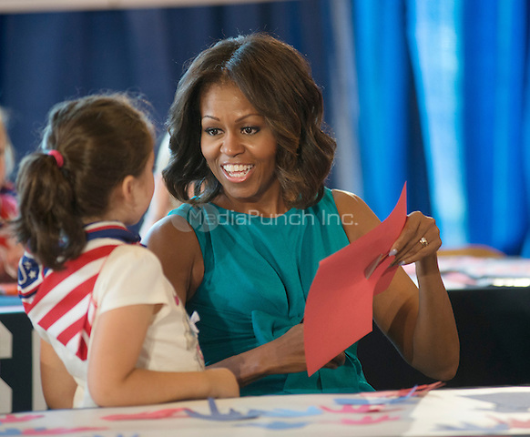 WASHINGTON DC - SEPTEMBER 11: First Lady Michelle Obama participates in a ribbon cutting ceremony for a new US0/Community Center for wounded warriors and their family and friends at Ft. Belvoir Army Base in Virginia. September 11, 2013. Credit: Lynch/MediaPunch Inc.