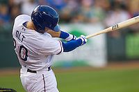 Round Rock Express third baseman Mike Olt (20) swings the bat against the Iowa Cubs in the Pacific Coast League baseball game on July 21, 2013 at the Dell Diamond in Round Rock, Texas. Round Rock defeated Iowa 3-0. (Andrew Woolley/Four Seam Images)