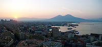 Situated on the west coast of Italy, Naples was originally founded by Greeks and later enlarged by Romans. The active volcano that looms over the Bay of Naples is Vesuvius. Vesuvius last erupted in 1944, but is infamous for the destruction of Roman towns Pompeii and Herculaneum in 79 AD.