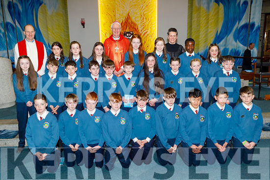 Miss Daly's Scoil Eoin Balloonagh 6th class receive their Confirmation from Bishop Ray Browne in St Brendans Church on Thursday with Miss Trina Daly and Fr Padraig Walsh.