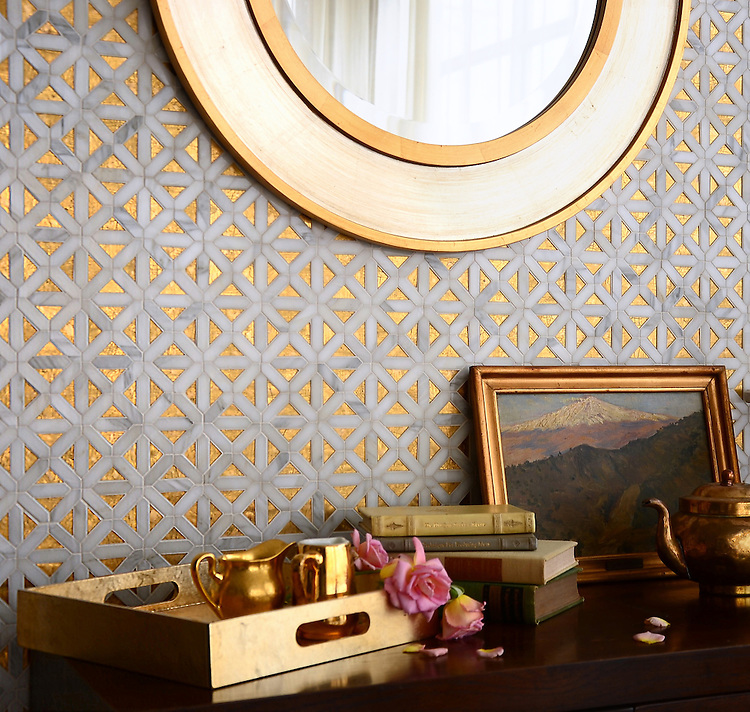 Joie, a handmade mosaic shown in honed 24K Gold Glass and polished Calacatta, is part of the Aurora® collection by New Ravenna.