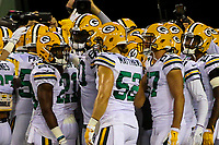 Green Bay Packers players huddle during a National Football League game against the Chicago Bears on September 28, 2017 at Lambeau Field in Green Bay, Wisconsin. Green Bay defeated Chicago 35-14. (Brad Krause/Krause Sports Photography)
