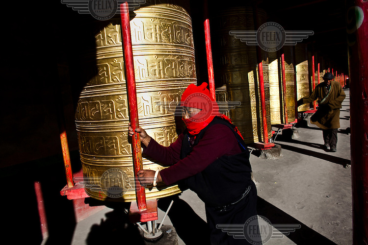 A man turns a prayer wheel at a monastery in Sichuan Province.