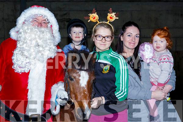 Ho Ho Horse at the Family Fun day at the Tralee Equestrian Centre on Sunday last,l-r, Santa Clause,Mason Burke on horseback, Rhianna McElligott, Jade & Dimi Burke.