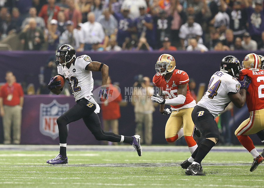 Feb 3, 2013; New Orleans, LA, USA; Baltimore Ravens wide receiver Jacoby Jones (12) scores a touchdown on a kick return against the San Francisco 49ers in the third quarter in Super Bowl XLVII at the Mercedes-Benz Superdome. Mandatory Credit: Mark J. Rebilas-