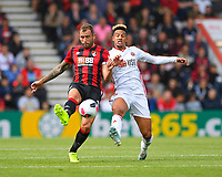 Steve Cook of AFC Bournemouth left comes under pressure from Callum Robinson of Sheffield United during AFC Bournemouth vs Sheffield United, Premier League Football at the Vitality Stadium on 10th August 2019