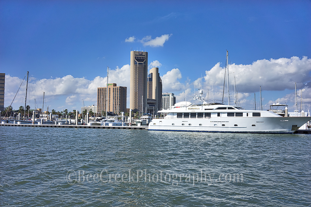 We captured this photo of Corpus Christi skyline with the marina and our yacht (just kidding) along with all the other boats in the marina on a day with beautiful blue sky and nice white clouds in the sky.