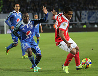 BOGOTA -COLOMBIA. 02-03-2014. David Ferreira (Der) de Independiente Santa Fe  disputa el balon contra Dahwling Leudo  de Millonarios   partido por la novena fecha de La liga Postobon 1 disputado en el estadio Nemesio Camacho El Campin. /   David Ferreira  (R)  of Independiente Santa Fe  fights the ball against Dahwling Leudo  of Millonarios  during the match for the nine round of The Postobon one league match at Nemesio Camacho El Campin  Stadium . Photo: VizzorImage/ Felipe Caicedo / Staff