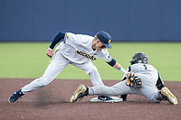 Michigan Wolverines second baseman Blake Nelson (10) applies the tag against Western Michigan Broncos baserunner Blake Dunn (1) at second base on March 18, 2019 in the NCAA baseball game at Ray Fisher Stadium in Ann Arbor, Michigan. Michigan defeated Western Michigan 12-5. (Andrew Woolley/Four Seam Images)