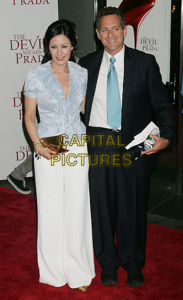 "LIZ CHO & BILL RITTER.""The Devil Wears Prada"" Premiere held at AMC Loews Lincoln Square, New York City, New York, USA,.19 June 2006..full length blue and white striped shirt ruffle stripes long skirt.Ref: ADM/AC.www.capitalpictures.com.sales@capitalpictures.com.©Alec Cole/AdMedia/Capital Pictures."