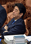 July 15, 2015, Tokyo, Japan - Japans Prime Minister Shinzo Abe listens to an opposition lawmaker during final deliberations on the governmet-sponsored security related bills in a Diet lower house special committee on national security in Tokyo on Wednesday, July 15, 2015. The committee voted to approve the bills with the support of the ruling Liberal Democratic Party and its junior coalition partner Komeito. The bills will be put to a vote in a Diet plenary session as early as July 16, after which it will be sent to the upper house. When enacted the measures will allow Japan to exercise its right to collective self-defense. (Photo by Natsuki Sakai/AFLO) AYF -mis-