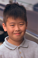 Boy age 8 smiling at Grand Old Day.  St Paul  Minnesota USA