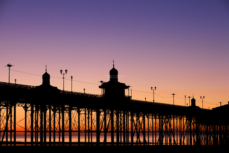 Blackpool North Pier, against a dramatic winter sunset. The Pier is closed at this time of year, and under the pier is roosting some 80000 starlings.
