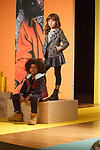 Models pose in outfits from the Andy & Evan collection during the petitePARADE fashion show at Children's Club in the Jacob Javits Center in New York City on February 25, 2018.
