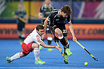 ENG - London, England, August 27: During the men semi-final match between Germany (black) and England (white) on August 27, 2015 at Lee Valley Hockey and Tennis Centre, Queen Elizabeth Olympic Park in London, England. Final score 2-2 (3-2 SO). (Photo by Dirk Markgraf / www.265-images.com) *** Local caption *** Michael HOARE #12 of England, Florian FUCHS #23 of Germany