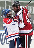 Ryan McGrath (UML - 10), Dax Lauwers (NU - 44) - The Northeastern University Huskies defeated the University of Massachusetts Lowell River Hawks 4-1 (EN) on Saturday, January 11, 2014, at Fenway Park in Boston, Massachusetts.