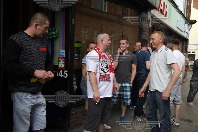 Polish football fans take a break from watching their national team playing in the Euro 2016 tournament to smoke outside a pub where the match is being broadcast. <br /> The town of Boston had the country's highest proportion of 'leave' votes cast in the EU referendum with almost 76 percent of ballots cast for Brexit. Lincolnshire has, in recent years, seen an influx of EU workers drawn to the area's agricultural industry. The 2011 census found about 13 percent of Boston's residents were born in Eastern Europe and migrated to the UK since 2004.