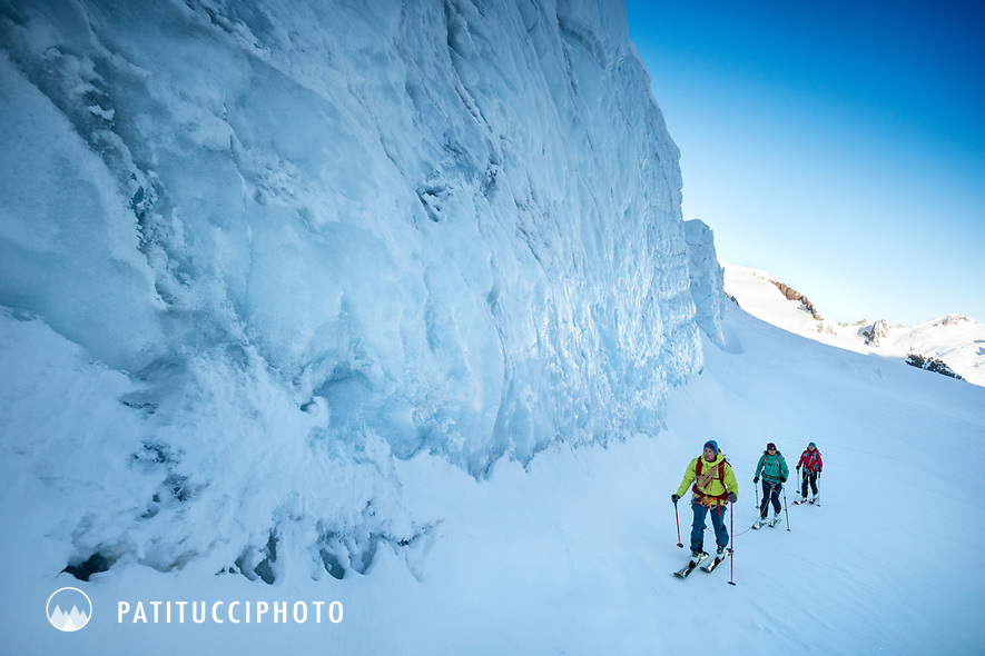 Ski touring on the Trift Glacier amongst seracs and crevasses while on a ski tour of the Berner Haute Route, Switzerland