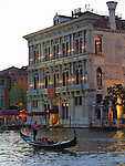 Gondolier on the Grand Canal, Venice, Italy.