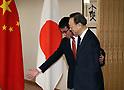 Yang Jiechi meets with Taro Kono