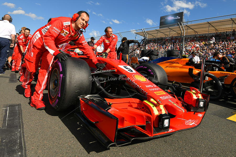 March 25, 2018: Mechanics wheel the car of Sebastian Vettel (DEU) #5 from the Scuderia Ferrari team on the grid prior to the start of the 2018 Australian Formula One Grand Prix at Albert Park, Melbourne, Australia. Photo Sydney Low
