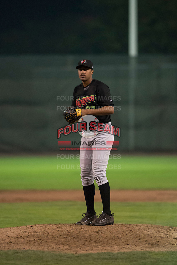 Great Falls Voyagers relief pitcher Devon Perez (32) gets ready to deliver a pitch during a Pioneer League against the Ogden Raptors at Lindquist Field on August 23, 2018 in Ogden, Utah. The Ogden Raptors defeated the Great Falls Voyagers by a score of 8-7. (Zachary Lucy/Four Seam Images)