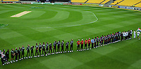 The teams observe a moment's silence for the victims of the terrorist attacks on the Sri Lankan cricket team in Lahore during the 2nd ODI cricket match between the New Zealand Black Caps and India at Westpac Stadium, Wellington, New Zealand on Friday, 6 March 2009. Photo: Dave Lintott / lintottphoto.co.nz