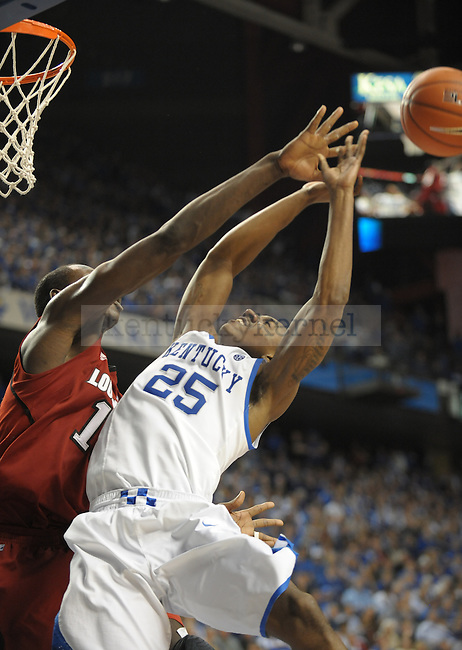 Kentucky's Marquis Teague (25) is blocked during the second half of the University of Kentucky Basketball game against Louisville at Rupp Arena in Lexington, Ky., on 12/31/11. UK won the game 69-62. Photo by Mike Weaver | Staff