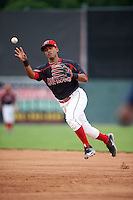 Batavia Muckdogs second baseman Giovanny Alfonzo (8) throws to first for the out during a game against the Mahoning Valley Scrappers on June 22, 2015 at Dwyer Stadium in Batavia, New York.  Mahoning Valley defeated Batavia 15-11.  (Mike Janes/Four Seam Images)