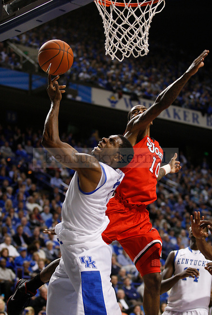 Terrence Jones and Nurideen Lindsey go up for the ball at Rupp Arena, in Lexington, Ky., on Thursday, Dec. 1, 2011. Kentucky beat St. Johns University 81-59.  Photo by Latara Appleby | Staff ..
