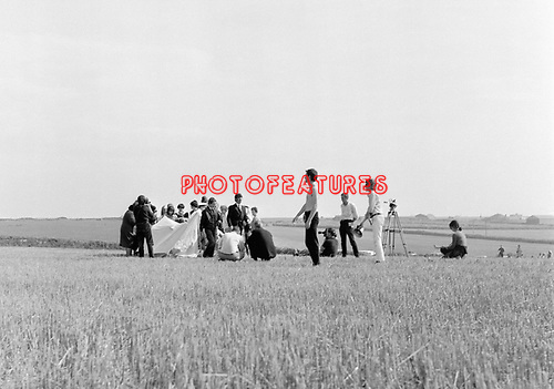 The Beatles 1967 Filming Magical Mystery Tour in a field near Newquay where the passengers are meant to be crowding into and leaving a small tent.<br /> © Chris Walter