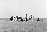 The Beatles 1967 Filming Magical Mystery Tour in a field near Newquay where the passengers are meant to be crowding into and leaving a small tent.<br /> &copy; Chris Walter