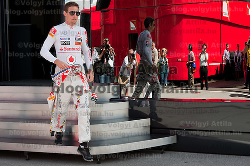 McLaren Formula One driver Jenson Button of Britain wears a Kalocsa design outfit before the free practice of the Hungarian F1 Grand Prix in Mogyorod (about 20km north-east from Budapest), Hungary. Saturday, 30. July 2011. ATTILA VOLGYI<br /> Team sponsor Hugo Boss celebrates its 30th anniversary with special fan made designs for competition saturdays on all races. On Hungaroring the special design is from Hungarian folk tradition with motives from Kalocsa.