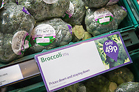 Broccoli on dispaly for sale in a supermarket