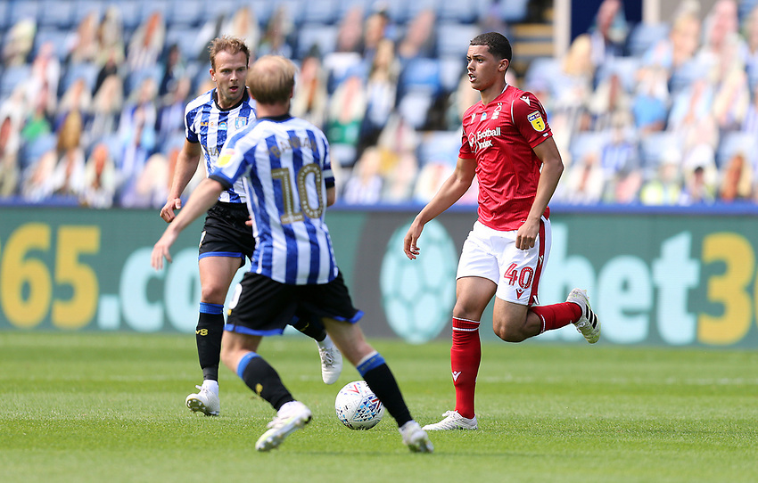 Nottingham Forest's Brennan Johnson looks to take on Sheffield Wednesday's Barry Bannan<br /> <br /> Photographer Rich Linley/CameraSport<br /> <br /> The EFL Sky Bet Championship - Sheffield Wednesday v Nottingham Forest - Saturday 20th June 2020 - Hillsborough - Sheffield <br /> <br /> World Copyright © 2020 CameraSport. All rights reserved. 43 Linden Ave. Countesthorpe. Leicester. England. LE8 5PG - Tel: +44 (0) 116 277 4147 - admin@camerasport.com - www.camerasport.com