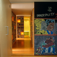 The children's rooms all lead off a library corridor which is shut off from the rest of the house by a sliding blackboard door