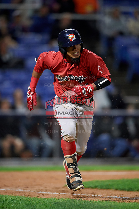 Portland Sea Dogs second baseman Deiner Lopez (24) runs to first base during a game against the Binghamton Rumble Ponies on August 31, 2018 at NYSEG Stadium in Binghamton, New York.  Portland defeated Binghamton 4-1.  (Mike Janes/Four Seam Images)