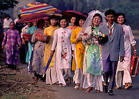 1992 - A traditional Wedding circa 1992 near Can Tho, the hub of the Mekong Delta (Vietnamese: Đồng bằng S&ocirc;ng Cửu Long &quot;Nine Dragon river delta&quot;), also known as the Western Region (Vietnamese: Miền T&acirc;y or the South-western region (Vietnamese: T&acirc;y Nam Bộ) is the region in southwestern Vietnam where the Mekong River approaches and empties into the sea through a network of distributaries. The Mekong delta region encompasses a large portion of southwestern Vietnam of 39,000 square kilometres (15,000&nbsp;sq&nbsp;mi). The size of the area covered by water depends on the season.<br />