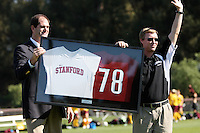 STANFORD, CA - OCTOBER 26:  Earl Koberlein presents Paul Ratcliffe of the Stanford Cardinal with a jersey commemorating his 78th career win, most in Stanford women's soccer history, during Stanford's 5-0 win over the Arizona State Sun Devils on October 26, 2008 in Stanford, California.