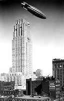 1930- His Majesty's Airship R-100, over the Canadian Bank of Commerce, the tallest building in the British Empire (Toronto, Canada)