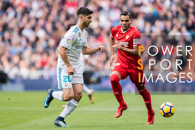 Marco Asensio of Real Madrid (L) in action against Gabriel Mercado of Sevilla FC (R) during the La Liga 2017-18 match between Real Madrid and Sevilla FC at Santiago Bernabeu Stadium on 09 December 2017 in Madrid, Spain. Photo by Diego Souto / Power Sport Images