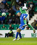 Hibs v St Johnstone....27.11.10  .Sam Parkin is fouled by Sol Bamba.Picture by Graeme Hart..Copyright Perthshire Picture Agency.Tel: 01738 623350  Mobile: 07990 594431