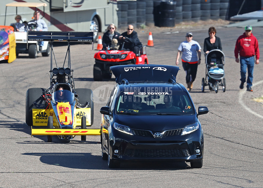 Feb 23, 2019; Chandler, AZ, USA; The dragster of NHRA top fuel driver Richie Crampton is towed back to the pits during qualifying for the Arizona Nationals at Wild Horse Pass Motorsports Park. Mandatory Credit: Mark J. Rebilas-USA TODAY Sports