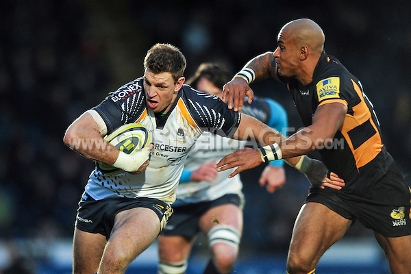 Nikki Walker looks to get past Tom Varndell. LV= Cup match, between London Wasps and Worcester Warriors on November 18, 2012 at Adams Park in High Wycombe, England. Photo by: Patrick Khachfe / Onside Images